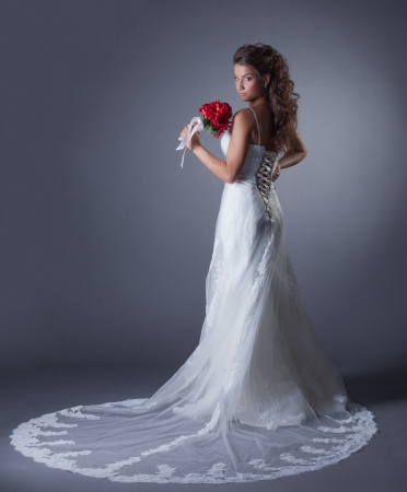 Image of charming bride posing in elegant dress, close-up photo