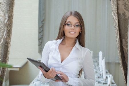 Beautiful business woman posing with tablet PC, close-up photo