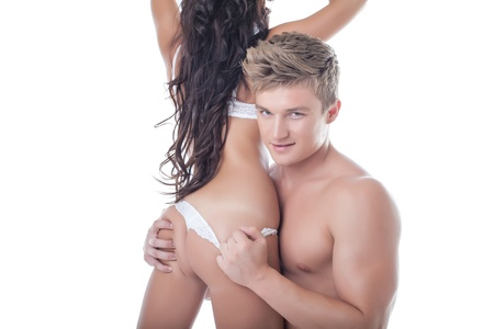 Portrait of horny muscular guy passionately hugging slim girl, isolated on white Stock Photo