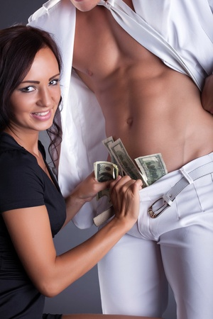 sex girl: Smiling girl puts dollars in strippers pants, close-up