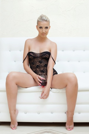 erotic dress: Exciting young blonde in erotic black dress, close-up Stock Photo