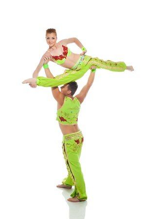 boy gymnast: Beautiful pair of gymnasts in colorful costumes, isolated on white Stock Photo