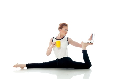 Image of woman posing in unreal pose with laptop, isolated on white photo