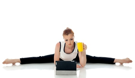 Concept of multi-tasking - Gymnast working on PC isolated on white