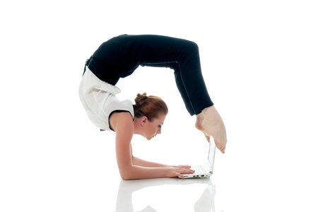 Businesswoman doing yoga and typing on netbook, isolated on white