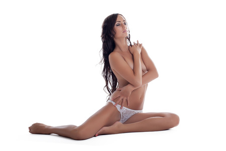 topless brunette: Thoughtful beautiful brunette posing topless, close-up Stock Photo