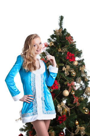 snow maiden: Cute blonde dressed as Snow Maiden posing near Christmas tree Stock Photo