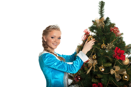Beautiful Snow Maiden decorating Christmas tree, close-up