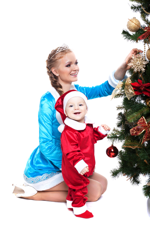snow maiden: Smiling mother and baby posing in Xmas costumes, isolated on white