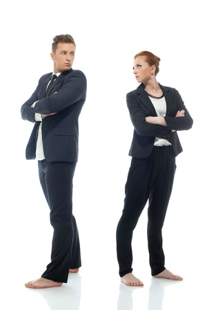 Strict business partners looking at each other, isolated on white photo