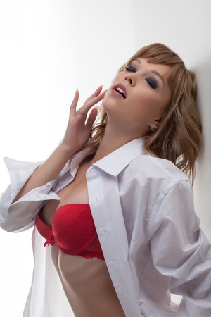 Portrait of beautiful excited girl posing in erotic clothes, close-up photo