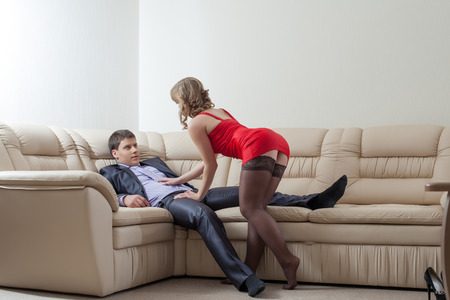 Image of curvy slim girl flirting with relaxing businessman Stock Photo