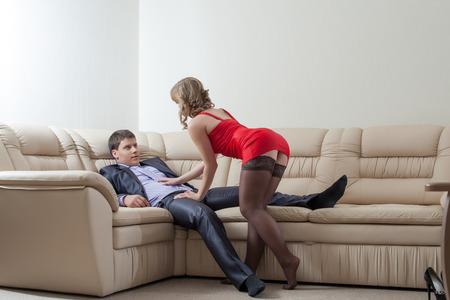 Image of curvy slim girl flirting with relaxing businessman Foto de archivo