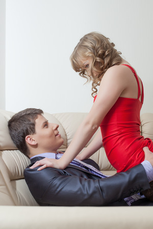 Portrait of playful sexy girl tempts businessman, close-up photo