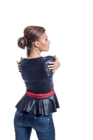 Image of stylish brunette posing back to camera, isolated on white background photo