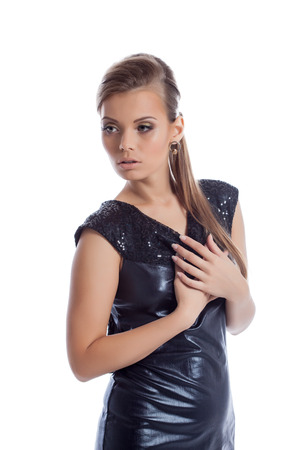 Beautiful young girl posing in shiny dress, close-up photo