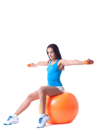 isolated woman: Confident girl exercising with dumbbells, isolated on white