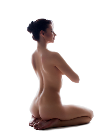 nude breast: Image of pretty slim girl posing nude in studio, isolated on white Stock Photo