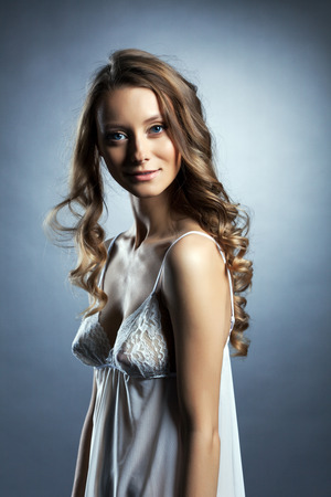 Image of pretty skinny brunette in white negligee, close-up