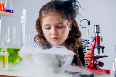 reagents: Pretty girl looking at reagents vaporization, close-up Stock Photo