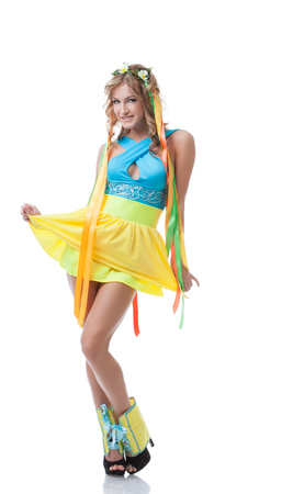 nude blonde girl: Cute Slavic girl posing in colorful national dress, isolated on white Stock Photo