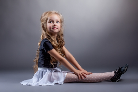 Adorable curly dancer posing in costume for performances photo
