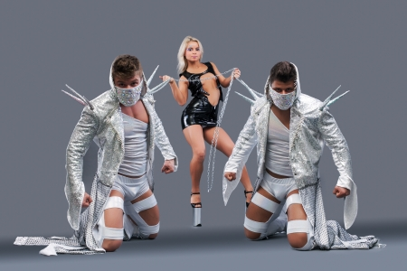 Dominant girl holding on chain strong guys in masks Stock Photo