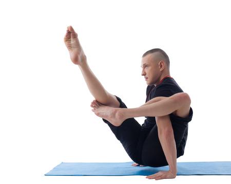 yogi: Image of young flexible yogi posing in complicated asana