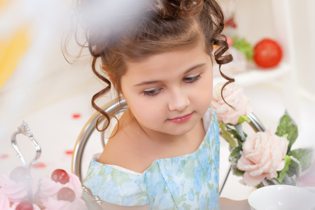eyes downcast: Portrait of elegant little brunette with downcast eyes