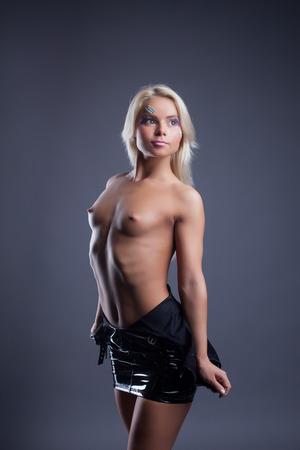 nude blonde woman: Beautiful petite stripper posing topless in studio