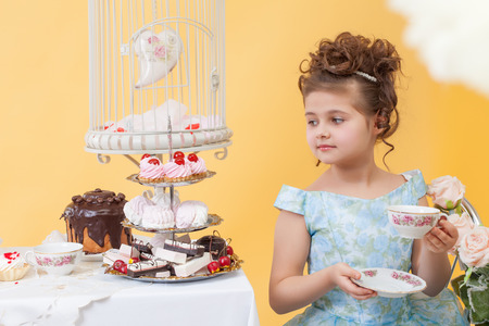smartly: Smartly dressed little lady drinking tea with sweets