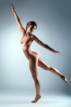 naked statue: Image of graceful nude woman with bronze skin posing in studio