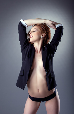 Portrait of excited topless girl posing in jacket, close-up photo