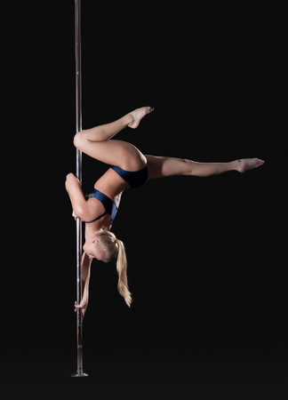 stripper pole: Image of slim graceful pole dancer, isolated on black Stock Photo
