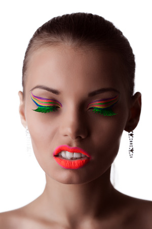 Face of beautiful girl with bright UV makeup, close-up photo