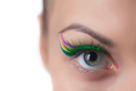 bright eyed: Gray-eyed girl with bright UV make-up, close-up