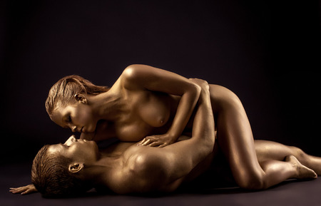 naked statue: Image of sensual nude lovers with golden skin, close-up Stock Photo