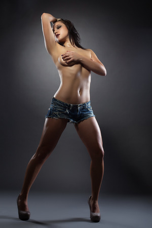 topless jeans: Image of hot topless brunette posing with eyes closed