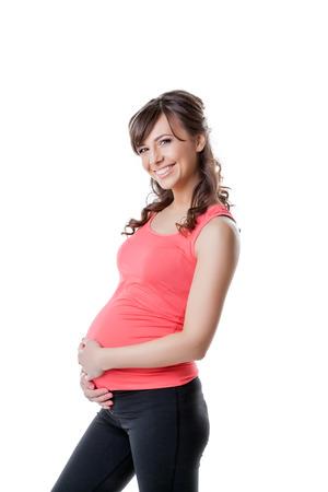 donna innamorata: Ritratto di donna incinta attiva, isolati su bianco