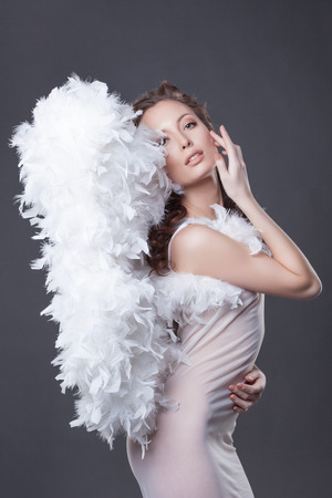 sexy angel: Image of beautiful woman posing with angel wings, close-up Stock Photo