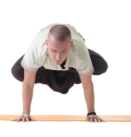 Image of meditator man doing yoga in studio Stock Photo