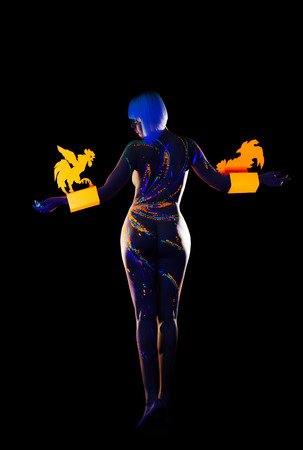Image of naked woman with UV makeup posing back to camera photo