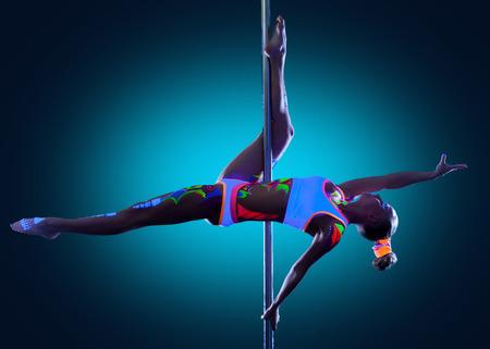 skinny girl: Image of amazing skinny girl dancing on pole in studio
