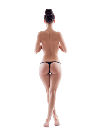 Image of slim topless girl posing in thong, back to camera Stock Photo