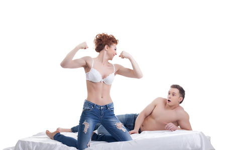 Surprised man looks at biceps of his mistress, isolated on white photo