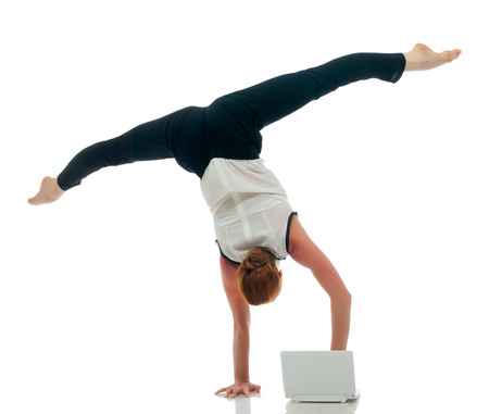 Image of businesswoman - acrobat working on laptop photo