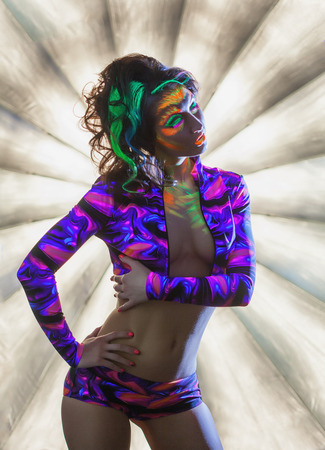 ultraviolet: Image of hot glamorous young woman posing in nightclub