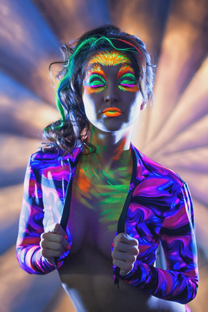 uv: Image of attractive woman posing with UV disco make-up