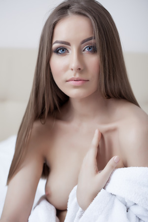 Portrait of lovely young woman posing topless, close-up photo