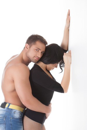 Image of hugging lovers posing in studio photo